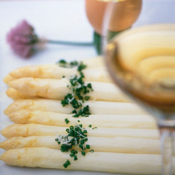 Asparagus dish with a glass white wine